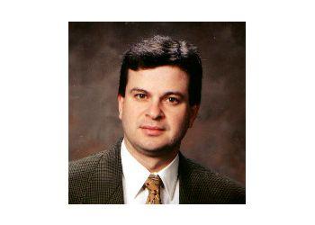 Clearwater cardiologist ALAND R. FERNANDEZ, MD, FACC