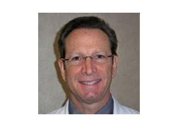 Coral Springs dermatologist Barry A. Sarkell, MD, FAAD