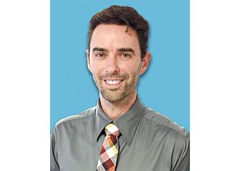 Dallas dermatologist Breck Thrash, MD, FAAD