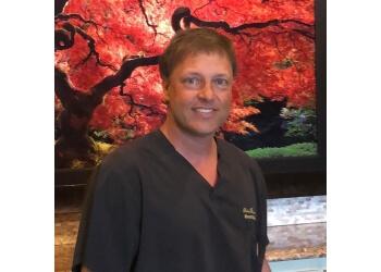 Tulsa plastic surgeon Brent A. Rubis, MD - RUBIS PLASTIC SURGERY