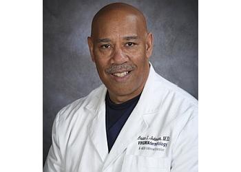 Norfolk dermatologist Brian L. Johnson, MD, FAAD, FACMS
