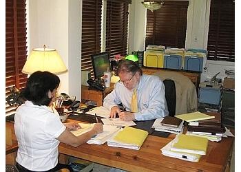 Laredo bankruptcy lawyer CARL M. BARTO