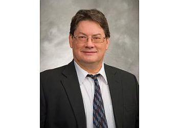 Indianapolis patent attorney C. JOHN BRANNON, PH.D.