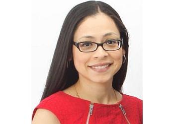 Austin immigration lawyer Carla Pérez Ramakrishnan