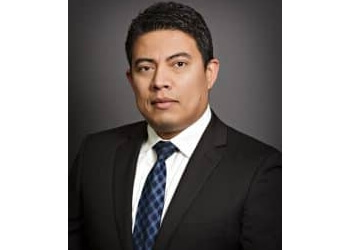 Hollywood immigration lawyer Carlos E. Sandoval