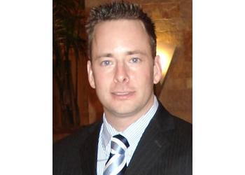 Arlington plastic surgeon CLAYTON A. FRENZEL, DO