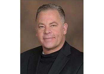 El Paso plastic surgeon DALE R. REYNOLDS, MD