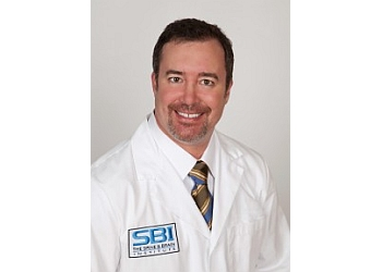 Henderson neurosurgeon DEREK A. DUKE, MD, FACS