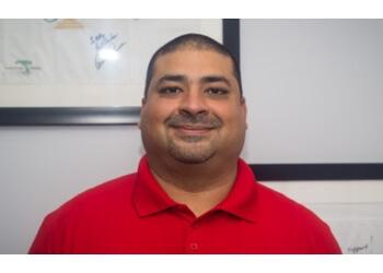 Charleston chiropractor DR. ALYKHAN SHARIFF, DC