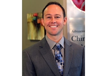 Overland Park chiropractor DR. BRAD M. WOODLE, DC, CCSP, FASA, CSCS