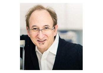 Boston pediatric optometrist DR. CURTIS FRANK, OD