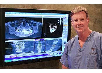 Jackson cosmetic dentist DR. GREGGORY THARP, DMD