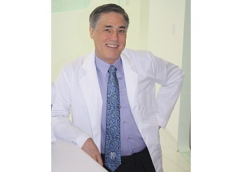 San Antonio cosmetic dentist DR. JOHN A. MOORE, DDS
