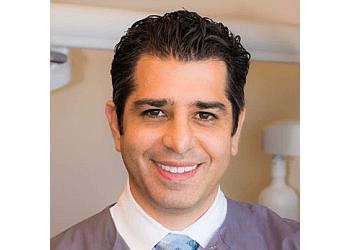 Alexandria dentist DR. KAMRAN TAVAKKOLI, DMD