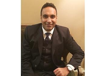 Waterbury cosmetic dentist DR. KANWARPAL SINGH, DDS