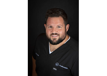 Midland cosmetic dentist DR. RYAN COULON, DDS