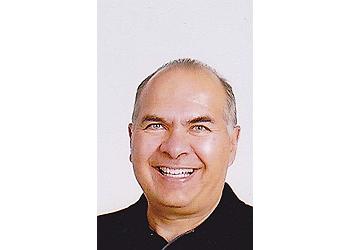 Scottsdale dentist DR. STEVEN POULOS, DDS