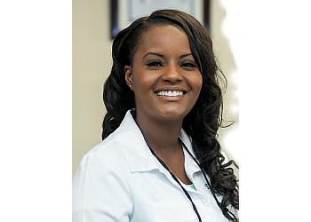 Coral Springs cosmetic dentist DR. TAMISHA DENIS, DMD