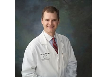 Fort Lauderdale plastic surgeon Don R. Revis, Jr., MD, FRCS