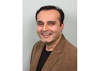 Arlington cosmetic dentist Dr. Aamir Budhani, DMD