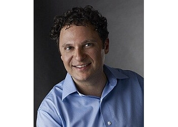 New York pediatric optometrist Dr. Abraham Zlatin, OD, FIAO