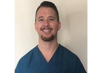 Jacksonville chiropractor Dr. Adam Crosby DC, ATC, FIAMA