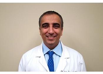Long Beach pain management doctor Amir Pouradib, MD