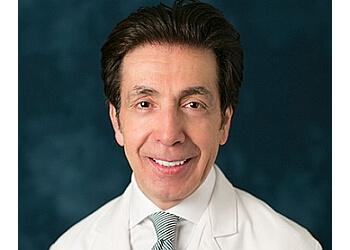Lubbock cardiologist AYMAN KARKOUTLY, MD, FACC, FACIP