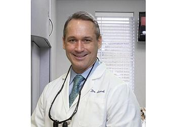 Kansas City cosmetic dentist Dr. Bill Busch, DMD, MAGD