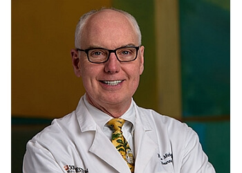 Dr. Bruce E. Mickey, MD