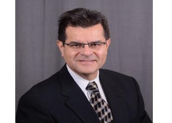 Grand Prairie orthodontist Dr. Carlos G. Wiesse, DDS, DABCP, FAACP, FAGD
