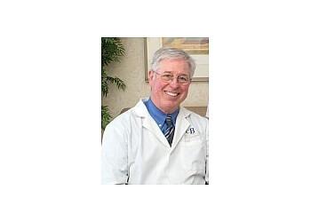 Louisville dentist Charles Barrett DMD, FAGD - BARRETT DENTAL CARE