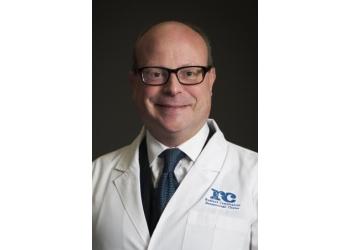 Des Moines dermatologist Charles W. Love, MD