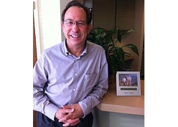 Garden Grove orthodontist Dr. Clark E. Schneekluth, DDS