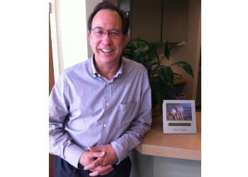 Garden Grove orthodontist Dr. Clark Schneekluth, DDS, MS
