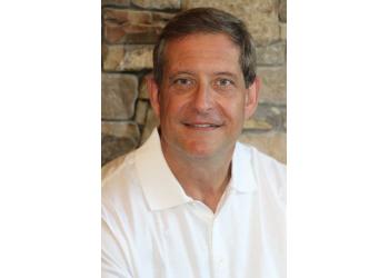 Raleigh cosmetic dentist Dr. Craig Q. Adams, DMD, PA