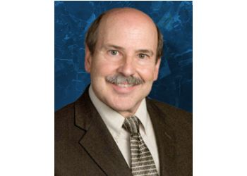 Lansing pain management doctor Dr. Curt Winnie, MD