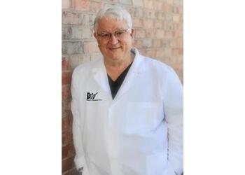 Amarillo cosmetic dentist Dr. David C. Woodburn, DDS