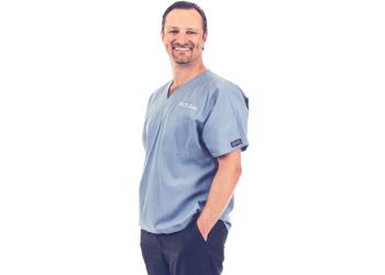 Bakersfield dentist Dr. Dimitri Salin, DDS, FICOI
