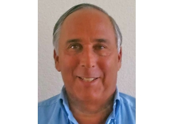 Colorado Springs plastic surgeon Douglas J. Raskin, MD, DMD