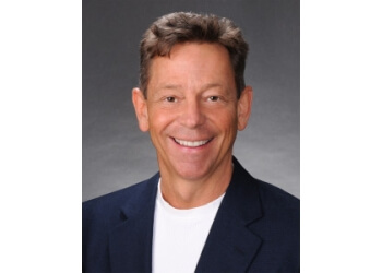 Cleveland cosmetic dentist Dr. Douglas W. Voiers, DDS, MHB, FWCMD, FAGD, FICOI