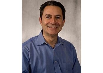 Akron dermatologist Dr. Eliot N. Mostow, MD