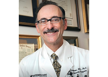 Dallas neurologist Elliot M. Frohman, MD