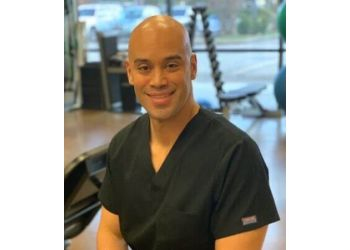 Houston physical therapist Eric Santiago, DPT, MSc, Dip. Osteopractic, CSCS - Trinity Physical Therapy