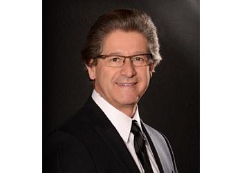 Dr. Ernesto M. Gomez, MD