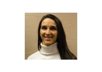 Lexington physical therapist Dr. Estee Saylor-Pavkovich, PT, DPT, FAAOMPT, Cert DN, Cert. Smt, Dip. Osteopractic, CIDN