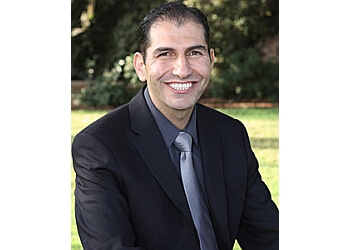 Dr. Feras Al Rezk, DDS, FAGD, DICOI