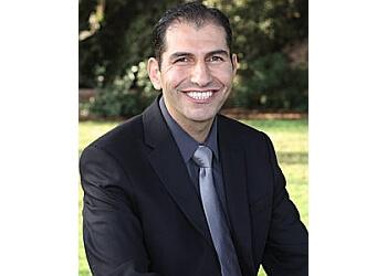 Visalia cosmetic dentist Dr. Feras Al Rezk, DDS, FAGD, DICOI