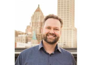 Tulsa cosmetic dentist Dr. Franklin J. Henrich, DDS