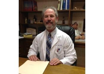Chesapeake plastic surgeon Dr. Fred H. Siegel, MD